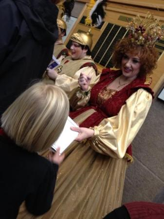 Cast members sign autographs after its popular holiday show Cinderella.