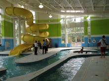 Families love the new indoor center with a three-story water slide and current channel, but some kids are getting blisters on their toes. The city responds.