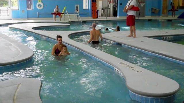 It's a balmy 80 degrees or so inside the Buffaloe Road Aquatics Center.
