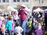 Ed Hoffman of the Sandbox band leads the kids in the hokey pokey.