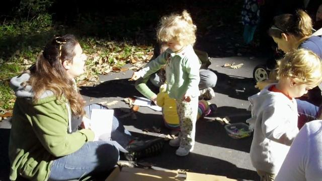 Kids gather leaves for leaf rubbings at a recent Cary Moms Playgroup event.