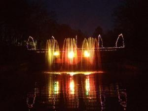Lights set to music at a fountain at Pullen Park for its Holiday Express