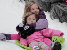 Children played in the ice and snow during Winterfest at City Plaza in downtown Raleigh on Sunday, Jan. 6, 2012.