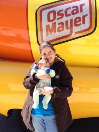 A new mom and her one-month-old son check out the Wienermobile.