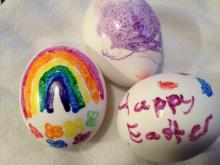 Warm Easter eggs decorated with crayons