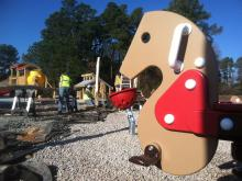 The new Knightdale Station park will open in phases beginning this summer. It includes a nice-sized playground with a large barn play structure.