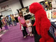 Elmo stopped by the Go Ask Mom booth at the Southern Women's Show on Sunday to meet with fans and tell them all about his upcoming show Sesame Street Live! Elmo Makes Music. It stops at the PNC Arena from May 31 to June 2!