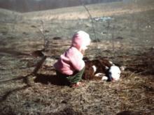 Lynda Loveland, age 2, visits with a calf.