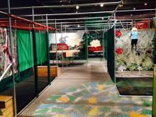 Kids can climb a spider web and hang from monkey bars at the new Rainforest Adventure exhibit