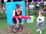 "Kristin Schmalzbauer performs ""The Hand Fish"" at Midtown Farmers' Market"
