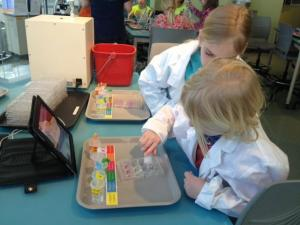 Kids work on a peanut allergy experiment at the Nature Research Center in downtown Raleigh.