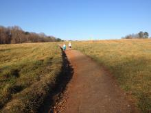 Walking along an unpaved trail at the Raleigh museum.