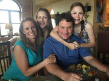 Amanda Lamb with her husband and two daughters.