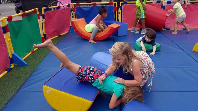 The colorful blocks inspire stacking and climbing at the Go Ask Mom event at North Hills Saturday, Sept. 12, 2015.