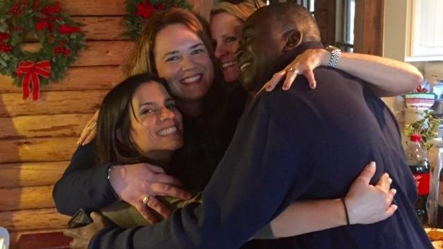 Amanda and WRAL colleagues get a big dose of happy with this hug.