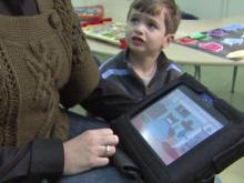 Seth Baldwin uses a DynaVox device to help him overcome speech developmental delays. He attends the Frankie Lemmon School in Raleigh, the oldest for special-needs children in Wake County.
