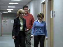 Cynthia Bulik, director of the UNC Eating Disorders Center, escorts anorexia patient Margie Hodgin and her husband, Tommy, to a therapy session.