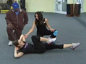 Aubrey Miller, a personal trainer at Bodyworks for Ladies in Wake Forest, instructs Arrington Howard on exercises to help tone up your stomach.