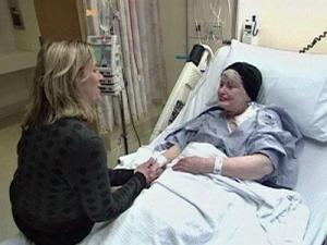 A member of the clergy meets with a terminally ill patient.
