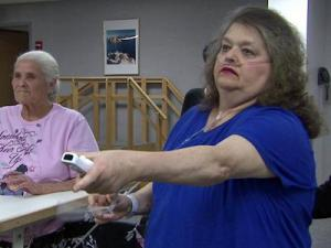 Pam Calloway, who underwent a quadruple heart bypass, uses the Nintendo Wii as part of her therapy at FirstHealth Moore Regional Hospital in Pinehurst.