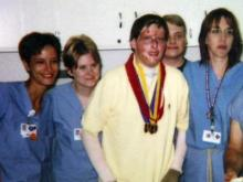 Blake Tedder and some of the staff of the North Carolina Jaycee Burn Center at UNC Hospitals in Chapel Hill.
