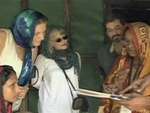 Dr. Coleen Cunningham talks with people in Bangladesh.