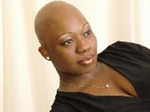 Sandra Dubose-Gibson, of Raleigh, was crowned as the 2011 Mrs. Black North Carolina at a pageant in Raleigh on Saturday, March 26, 2011. Twelve years ago, at age 25, Dubose-Gibson lost all her hair to alopecia, a disease that causes the body's immune system to attack hair follicles. (Photo courtesy of Ms/Mrs/Mr Black NC)