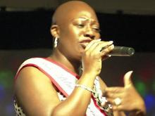 Bald beauty queen sings at Southern Women's Show
