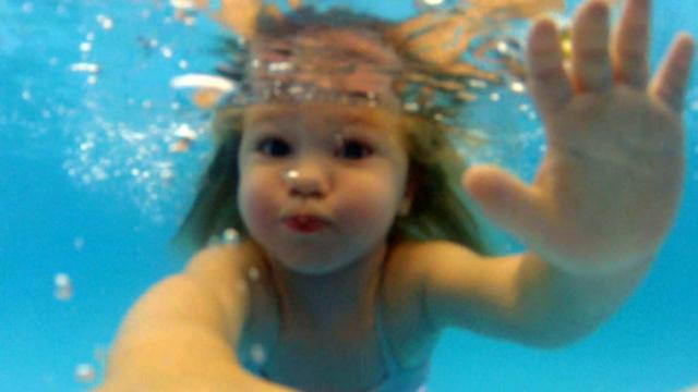 Ellie Grover takes an Infant Swimming Resource class.