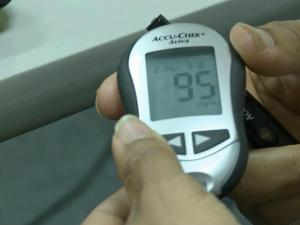 Diabetes patients use a blood glucose monitor to check blood sugar levels.