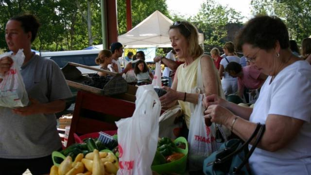 Shoppers were enthusiastic, and well-mannered, at the Durham Farmers' Market. Photo by Dolly R. Sickles.