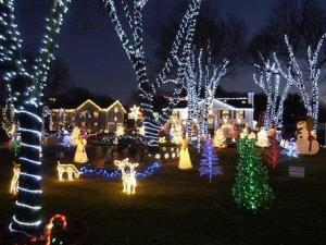 The home of Michael Conlon is decorated with approximately 85,000 lights, seen in this Saturday, Dec. 23, 2006 file photo along the Lynn Fells Parkway in Saugus, Mass. (AP Photo/Lisa Poole, FILE)