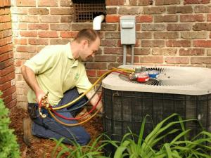 Brant Wurster, HVAC manager for Green Horizon, performs an HVAC tune-up for a Raleigh homeowner.