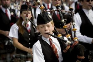 A piper marches during a procession at the 52nd Annual Highland Games held at Grandfather Mountain.