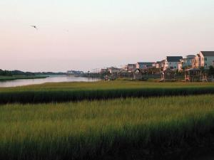 Pawleys Island is bordered by the Atlantic Ocean on one side and a marsh near the Waccamaw River flowing into the Winyah Bay on the other.