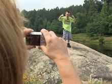 Tonya Mangum takes a picture of her 9-year-old son Alex at DeHart Botanical Gardens, off U.S. Highway 401 near Louisburg in Franklin County.