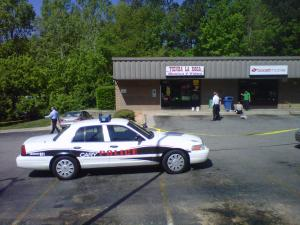 Cary police are investigating an armed robbery in a strip mall in the 1400 block of Southeast Maynard Road Monday, April 16, 2012.