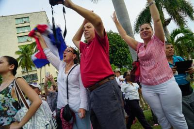 Cubans cheer and wave as Pope Francis passes by.