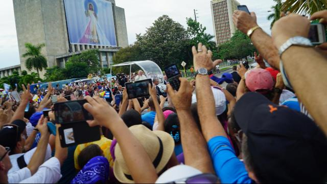 Cell phones and tablets popped into the air capturing who was coming directly our way, Pope Francis.