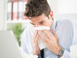 Experts believe the flu is spread in droplets that can become airborne when people with the flu sneeze, cough or talk.