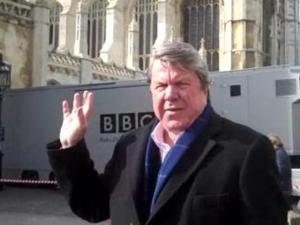 """WRAL anchor David Crabtree stands outside the chapel of Kings College in Cambridge, England, were James McMillan's masterpiece """"Saint John Passion"""" was performed on Good Friday, April 2, 2010."""