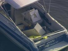 Sky 5 hovers over Falls Lake boat explosion