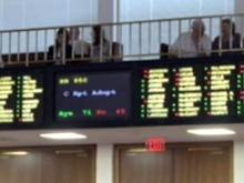 House adopts budget compromise