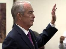 Duke Energy Chief Executive Jim Rogers is sworn in on July 10, 2012, before testifying to the N.C. Utilities Commission.