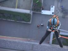 WRAL meteorologist Elizabeth Gardner rappelled 30 stories off the Wells Fargo Capitol Center Building on Fayetteville Street in downtown Raleigh to raise money and awareness for Special Olympics North Carolina.