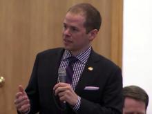 House debates Blue Cross contracts bill