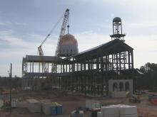 Raw: Crews raise dome of new Catholic cathedral in Raleigh