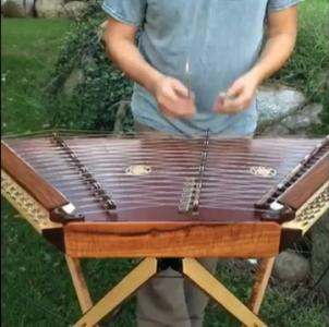 "You didn't know you desperately needed to hear ""Everybody Wants to Rule the World"" on a hammered dulcimer until this moment. (Deseret Photo)"