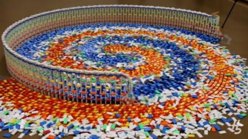 Fifteen thousand dominoes, four spiral layers, and one minute of satisfying entertainment. (Deseret Photo)
