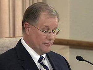 Wake County schools Superintendent Del Burns announces at a school board meeting Feb. 16, 2010, his intent to resign, effective June 30.
